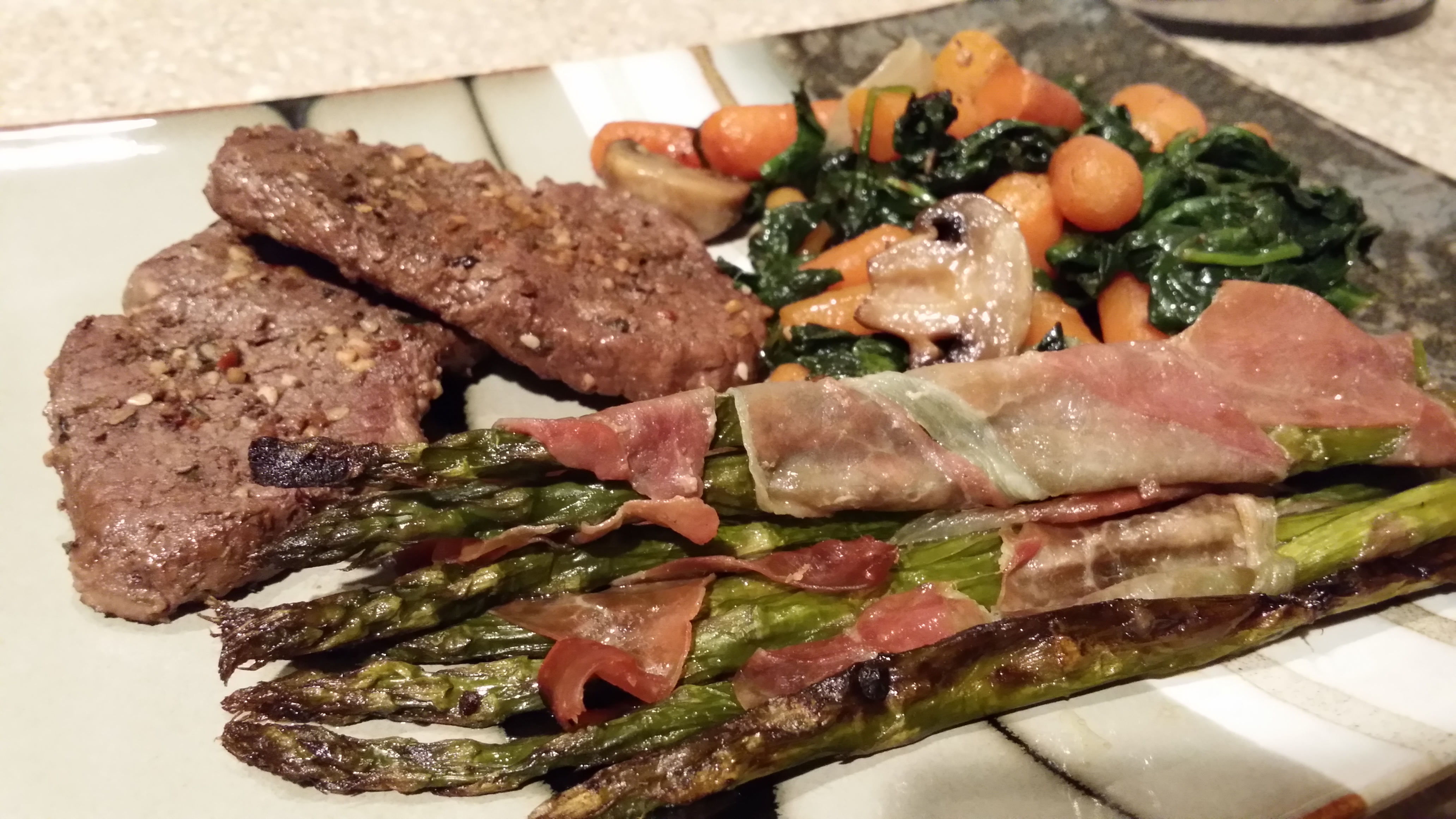 Venison Loin Chops with Roasted Carrots, Spinach & Mushrooms with Prosciutto Wrapped Asparagus